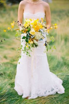 This is a beautiful example of how bouquets can be mixed with flowers, greenery, and branches.