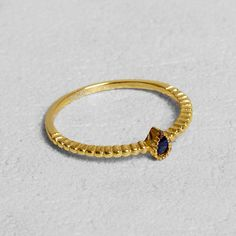 Petit Sesame | Gold-plated deep blue ring | Designed by Petit sesame | $16.00 | 18k gold plated silver 925 ring adorned with a blue cubic zirconia stone