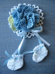 This hand crocheted Boy Baby Shower Corsage is made with blue, white and frosty green color crochet cotton thread, size 10. Accented with blue and white