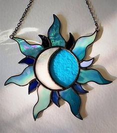 Multicolour sun crescent moon iridescent sun light catcher stained glass window wall hanger celestial space symbol symbolism charm ornament. DIMENSIONS: (not including chain, approximate width & length) 16cm W X 16cm L Please note: each and every beautiful sun created will be #StainedGlassLight