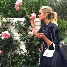 When she held her purse like a proper belle:   22 Times Reese Witherspoon Proved Being A Southern Belle Is A Way Of Life