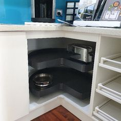 Vauth Sagel's COR Wheel Pro unit is ideal for under corner sinks or any corner cabinet with two opening doors. It's brilliant for retrofitting and is designed with minimal visible mechanisms, so it looks great when the doors are open. Seen here in the Planero style (powder coated steel baskets) in Concept Kitchens and Bathroom's showroom.