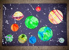 Make a Solar System w/ Paint 1st Make circles, then splatter white on black construction paper, Glue colored/painted circles onto black paper.