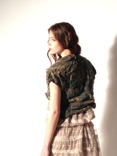 Camouflage vest on a romantic lace dress  #shooting #backstage #dress #lace #camouflage #military #vest #madeinitaly