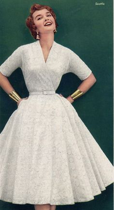 1950s Fashion - sporting the Wonder Woman cuffs decades before! vintage style 50s dress full skirt white lace day or party color photo print ad model magazine