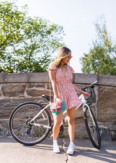 Stylish bike riding outfit idea: Red Romper & Converse | White Converse high tops outfit | Converse high tops outfit summer | Central Park biking | Cherry print red romper | What to wear when riding a bike | NYC street style summer | Summer outfit ideas | High Top Converse Outfits, Dress With Converse, White High Top Converse, Red Converse, High Tops, Baskets Converse Blanche, Outfits Damen, Summer Dress Outfits, Spring Outfits