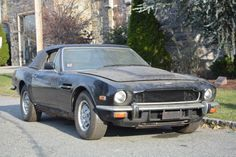 This incredibly honest and original 1979 Aston Martin Volante convertible . It comes with it's manual transmission which is currently out of the car and it's air cleaner as well. This V8 Volante is chassis number 15020, the 20th example built. Black with Tan leather. Be the first to restore it for only $89,500 #gullwingmotorcars #classiccars #buy&sellclassiccars #VintageCarBuyer #ClassicCar #antiqueCarBuyer