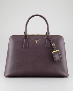 """Loving the new """"it"""" color of the moment, Bordeaux, as displayed in this fabulous Prada double-zipper bag."""