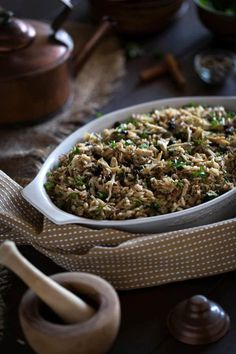 A chicken and rice dish with Ottoman/Turkish flavors like currants, fresh herbs, and lightly roasted pine nuts. An old family recipe.
