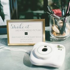 Forget the photo booth and buy a Fuji Instax or digital Polaroid instead. Set up a photo station with a cute backdrop and ask your guests to leave you a snap with a note. This can double as your guestbook or a favor for friends and family to take home.