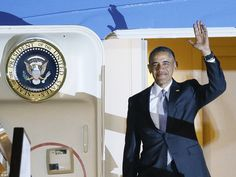 Arrival: Mr Obama waves for the cameras after landing at Stansted Airport outside London o...