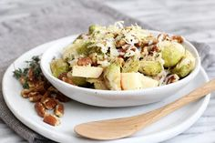 Roasted Brussels Sprouts with Apples (Omit cheese and use olive or avocado oil instead of ghee to make it vegan. Also to make even healthier, use vegetable broth instead of the wine vinegar.) #gf