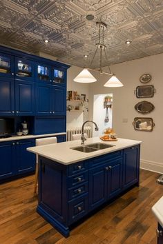 8 Shining Examples of Tin Tiles in the Kitchen
