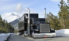 Black Peterbilt in the mountains