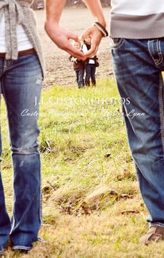 Whoever shot this needs to work on the positioning a bit, but Love the idea ... Shot an engagement pic like this with the ring inside the heart.  Would be cute to hang on the wall next to a picture of any kids they have :)