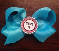 3.5 wide grosgrain ribbon bow with thing 3 bottle cap. Beautiful and high quality 1.5 bright blue ribbon. Single prong alligator clip