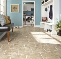 This porcelain tile floor is durable, easy to clean, and low maintenance.