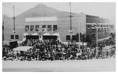 This photograph shows the Convention Hall, which was built in 1925 to accommodate the 1925 West Texas Chamber of Commerce Convention. The lack of signage on the front of the building--along with copious bunting--suggests that the photograph was taken at its dedication.