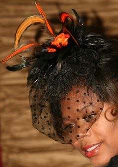 Womens Hats - Orange and black feathered and flower fascinator
