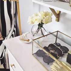 10 Seriously Chic Ways to Decorate Your Vanity Keep items that you want to stay free of dust in a vintage glass box. You'll see be able to view them, but they won't get dirty.