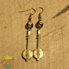 Hey, I found this really awesome Etsy listing at https://www.etsy.com/listing/245160649/colorful-bead-bronze-banjo-earrings