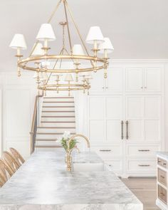 Excited to share this client's new kitchen with you! The back staircase added so much charm to this room. The soft and natural palettes… Decor Interior Design, Interior Decorating, Kitchen Chandelier, House Stairs, Black Kitchens, T 4, New Kitchen, Kitchen Office, Kitchen Ideas