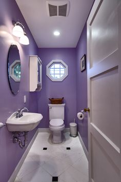 Purple Bijou powder room. #bathrooms #powderroom #purple #mirrors #windows #basin #floortiles