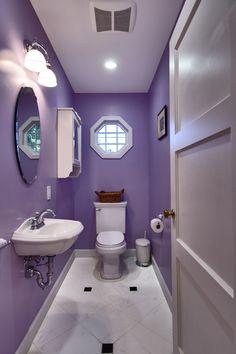 Purple Bijou powder room. #bathrooms #powderroom #purple #mirrors #windows #basin #floortiles