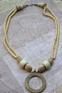 White Wood Seed Bead Necklace with Gold Donut Pendant on Etsy, $32.00
