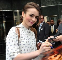 Lily collins signing autographs