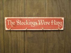cute saying for wooden stocking hanger....this plan also keeps the stockings out of ben's reach (but they wouldn't be on my mantle...)