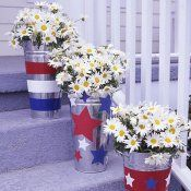 Arrange Buckets of Pretty   Daisies        Decorate the steps with pails full of pretty wildflowers. Give ordinary   galvanized flower buckets a unique look by painting red, white and blue stripes   and pasting paper star cutouts on them.