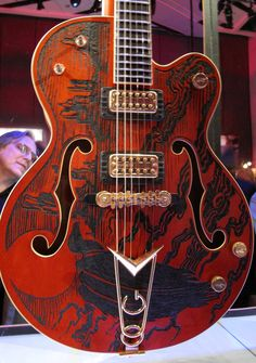 Gretsch  (6120?) with burnt/carved top