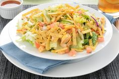 Course(s): Entrée; Ingredients: chicken breast, cooking spray, corn tortilla, fat-free sour cream, ground cumin, hot pepper sauce, Mexican blend cheese, romaine lettuce, salsa, salt, tomato