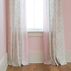 French Gray and Pink Damask Drapes (Set of 2) | Carousel Designs. Window drape panel in French Gray Damask with coordinating side trim in Solid Pink. Add a designer feel to your baby's room with these stylish and versatile Hidden Back Tab Drape Sets. Each pair of drape panels is produced with hidden belt loops and a rod pocket to give you the option of soft pleats or a fuller, gathered look. Both styles are sure to enhance any room. Includes two 84-inch panels, approximately 25.5 inches wide…