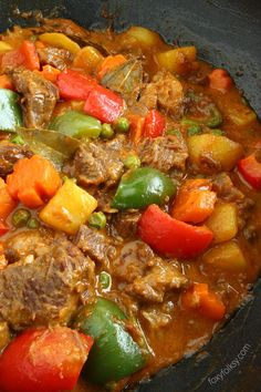 Beef Kaldereta (or Caldereta) is a Filipino spicy tomato-based beef stew loved by many Filipinos. This spicy dish is commonly served on holidays and special occasions. Beef Kaldereta Recipe, Beef Caldereta, Pork Recipes, Asian Recipes, Cooking Recipes, Ethnic Recipes, Vegetarian Recipes, Healthy Recipes, Gourmet