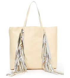 Everyday shopper tote by SARA BATTAGLIA. Swingy fringe punctuates the front of this slouchy Sara Battaglia tote. The metallic, unlined interior includes an op...