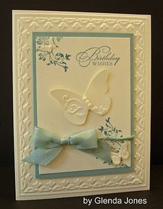Happy Birthday card--uses Stampin Up's tulip border embossig folder and beautuful wings embosslits.