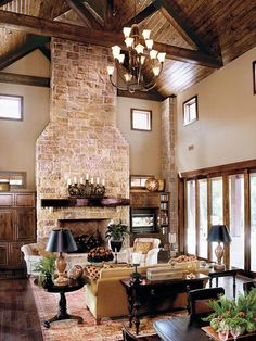 Family Room in Texas Hill Country style home... I really like this decor. It suits the architecture without going overboard. There are no dead animals on the wall. ;)
