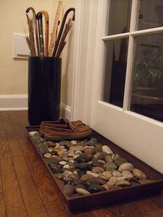 add a boot tray with rocks to have less mess in entyway.rocks drain water so your shoes will dry faster when they are wet. for mud room Shoe Tray, Shoe Storage Tray, Interior Design Living Room, Living Room Decor, Cottage Hallway, Entryway Shoe Storage, House Entrance, Diy Garden Decor, Mudroom