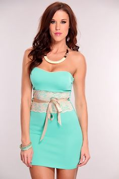 This sexy party dress will have all those around you feeling the heat! Because this is one hot hot hot tube top mini! With its bold zig-zag decor youll have no trouble pairing it with your fave pair of heels. Glam up this sexy frock with dangle earrings and a pair of leggings for a look thats too hot to handle! Featuring a sweet heart neckline, with scalloped trim, lightly padded bra top, sleeveless, fitted laced detailed waist complete with a faux satin bow tie.