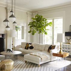 Gorgeous living room! Spotted: Fiddle Leaf Fig Tree + Gold Moroccan Pouf