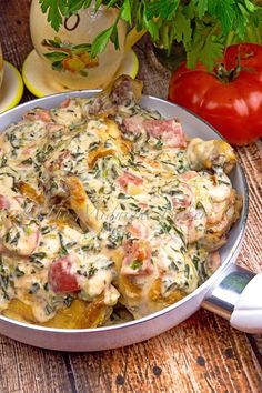 Juicy chicken in a tomato and spinach based creamy alfredo sauce