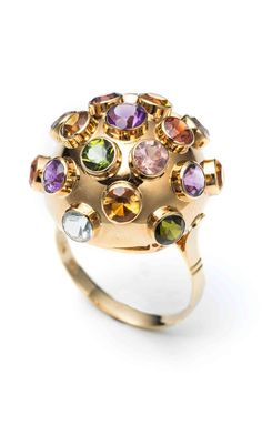 You've got to love a good sputnik ring. This vintage ring from the 1970's features richly colored natural stones (peridot, carnelian, garnet, amethyst, aquamarine, rose quartz) in bezel settings on a sleek 18K gold dome. Stamped with an unknown maker's mark.