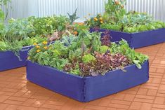 3 Oversized Planters You Can Make From Upcycled Items | HGTV Wooden Raised Garden Bed, Building Raised Garden Beds, Raised Beds, Unique Gardens, Small Gardens, Raised Gardens, Pot Jardin, Backyard Garden Design, Hillside Garden