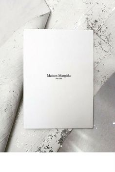 sneakers and pearls, how to take nice black and white photos, white invitation, Maison Margiela.jpg