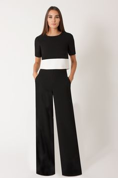 "Black Halo - Leilani 2 Piece Jumpsuit - Black Sugar | Dress to impress in the Leilani 2-piece stretch pebble crepe jumpsuit. It can be pared down for a more relaxed look or elevated with accessories and heels. The color-blocked short-sleeve top features a hidden specialty metallic zipper at back neck and measures 17"" from the shoulder. The palazzo wide-leg pants are designed to flatter with inside button and invisible zipper to ensure a neat fit at the waist. Pants measure 35 1/2"" from…"