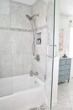 I love these shower doors on the tub. They look like they would be easy to clean. ??? bathroom makeover reveal