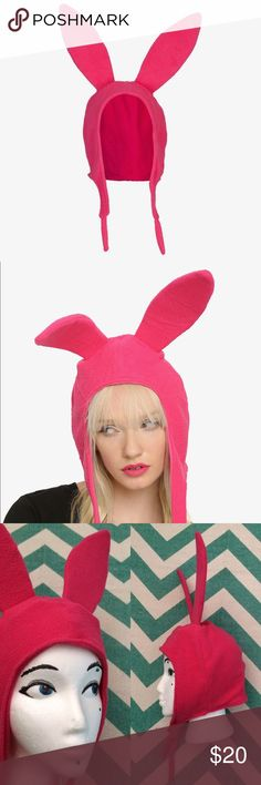 NWOT Bob's Burgers Louise Pink Rabbit Ear Hat Need a super quick Halloween costume or just LOVE Bob's Burgers? Grab up Louise Belcher's trademark pink bunny hat. One size. NWOT. Made of hot magenta fleece and enforced with foam; ears really do stand up! Pair with a green top and you're ready to spook it up or help Dad run the restaurant (don't forget to set the burger of the day)! Hot Topic Accessories Hats