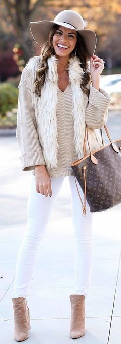 #winter #outfits  beige v-neck long-sleeved shirt with white jeans, brown booties, leather 2-way bag and hat